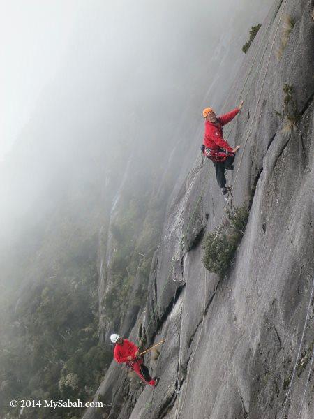climbing on foggy slope