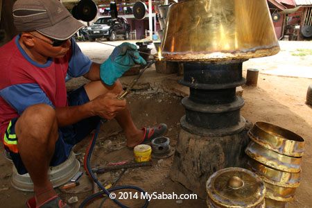 craftsman making gong