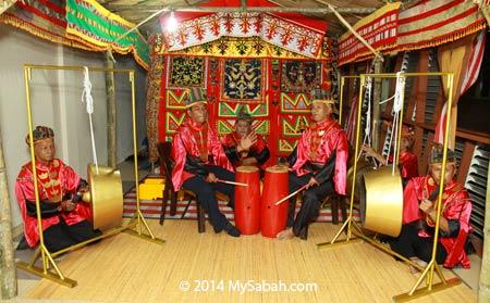 Land Bajau playing gong