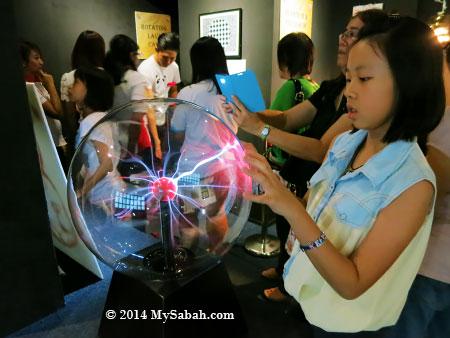 kid playing with Nebula globe