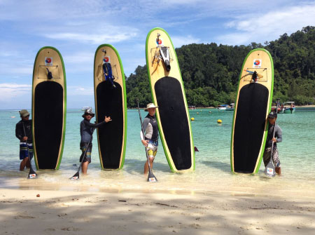 taking Stand Up Paddle Boarding lesson on the sea