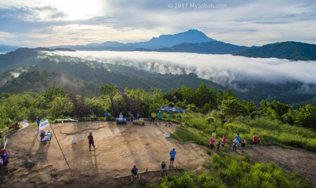 Hikers relax and enjoy the morning view on Bukit Perahu
