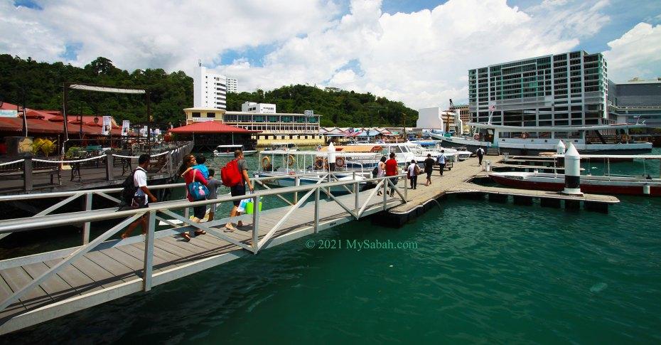 Tourists boarding in Jesselton Point Ferry Terminal