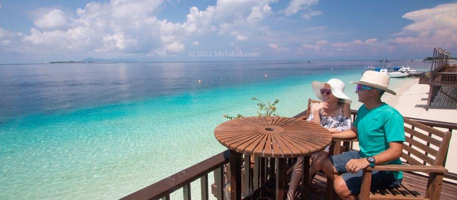 Couples enjoy the sea view of Mataking Island (Pulau Mataking)