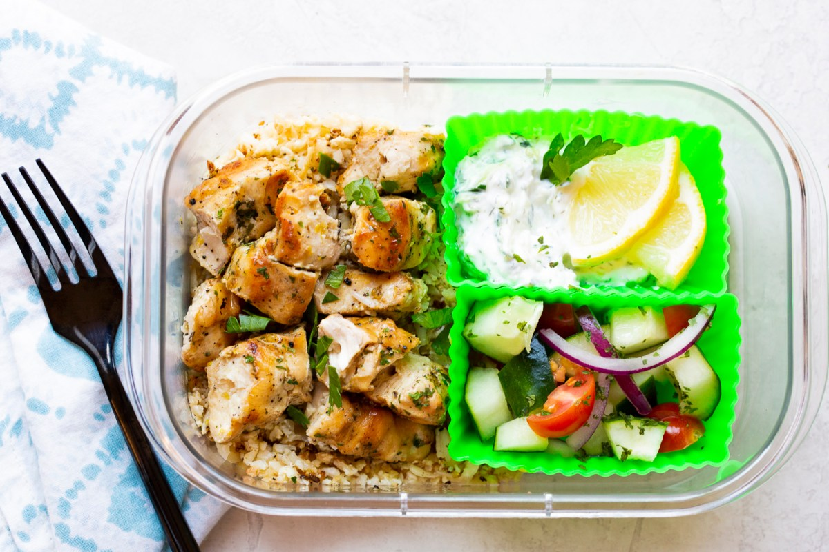 chicken souvlaki with tatziki and salad