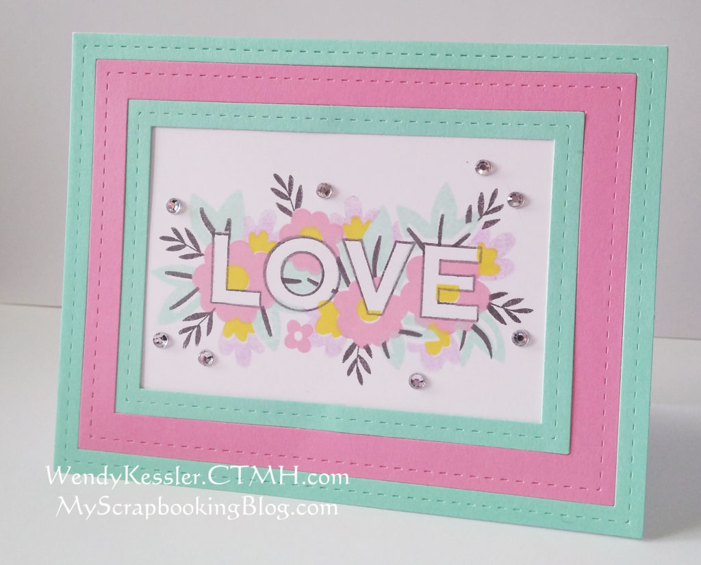 This card is created using a multi-step stamp by Close to My Heart with the word Love, in addition to the new Thin Cut Rectangle Frames.