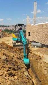 U30 digging trenches for pipe laying and other plumbing lines.