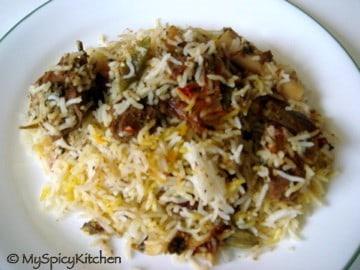 goat biryani in a plate