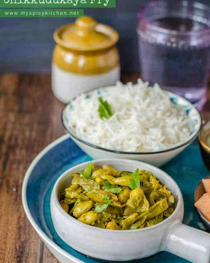 A bowl of chikkudukaya kura or Indian broad beans in a platter along with a bowl of rice.