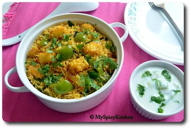 Bell Pepper Paneer Pulao in a white casserole dish