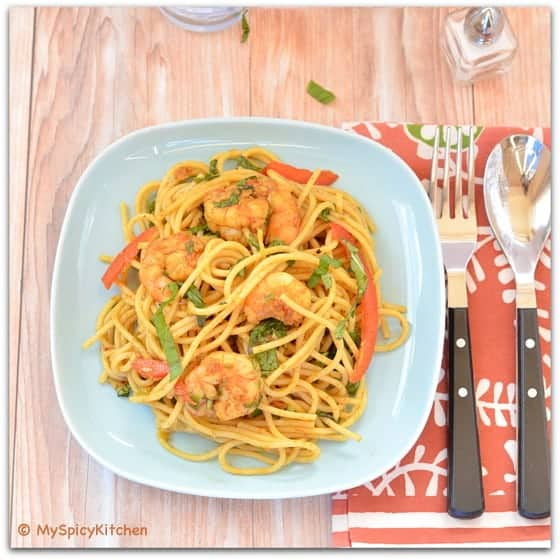 Curried Spaghetti Salad served inn a blue plate and angle of the image is top down