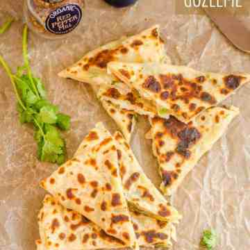 Wedges of patatesli gozleme wedges on wax paper
