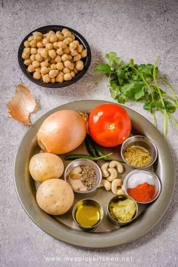 Ingredients for chana masala in a tray and chickpeas on the side