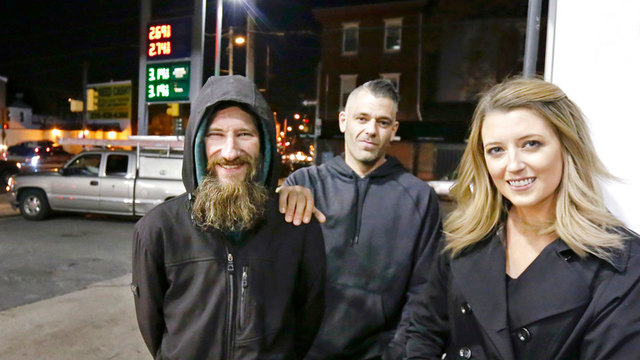 Homeless man helps woman