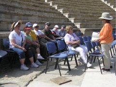 Tour guide Hela Crown-Tamir explains the biblical events that occurred in this Roman theater in Caesarea. (2011)