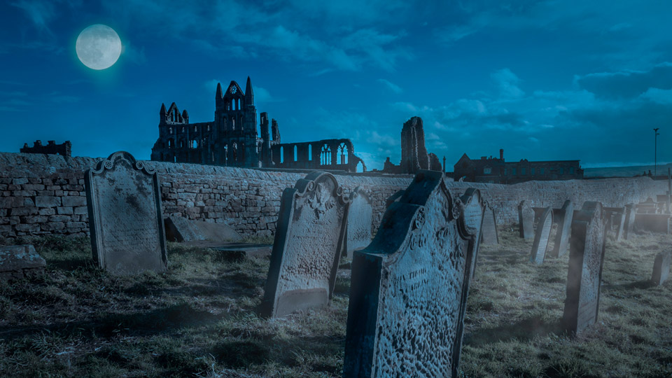 Graves in St Mary's churchyard, Whitby, with the abbey ruins in the background