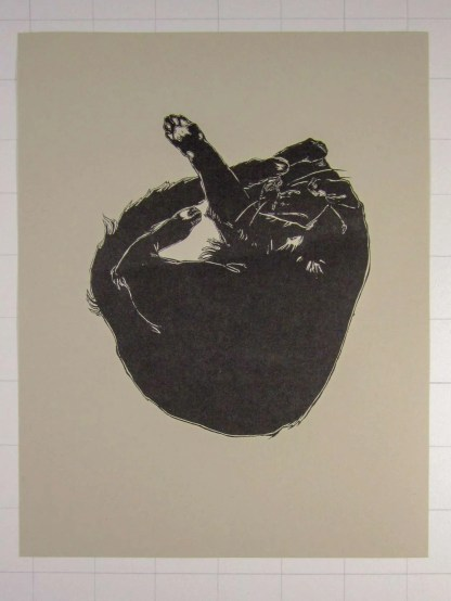 """Baby Kitty"" risograph art print showing a curled up black cat illustration with one paw stretched out"