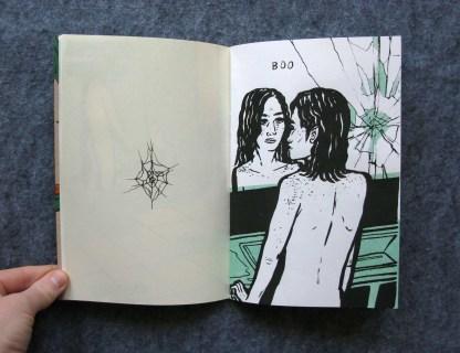 Woman looking at reflection saying boo
