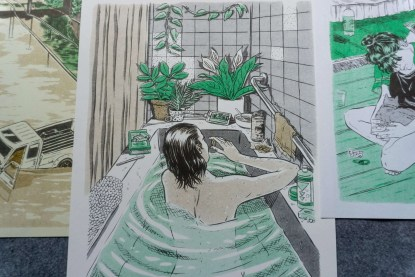 Woman relaxing in bathtub eating chocolate and watching video