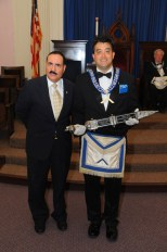 Dr. D. Saluti, President, Greater Boston Sons of Italy, presents Wor. Privitera with the Legionnaire's Sword.