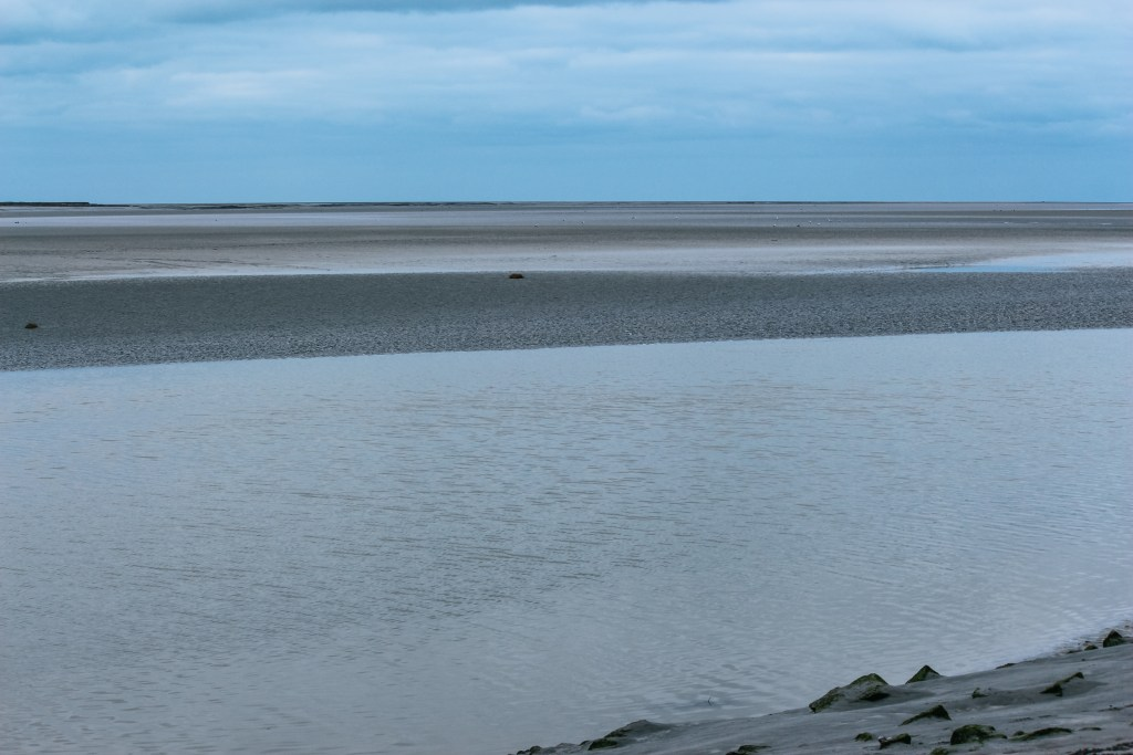 The tidal zone around Mont Saint-Michel Monastery in Normandy, northern France.