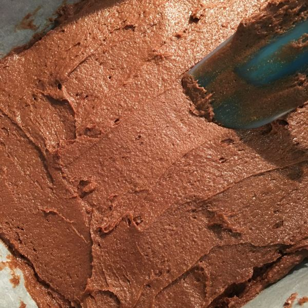 """Put the mixture into the prepared <a href=""""http://amzn.to/2sKSgZC"""" target= """"_blank"""">baking pan</a>, and spread it out evenly, using a <a href=""""http://amzn.to/2sPueMv"""" target= """"_blank"""">spatula</a>."""
