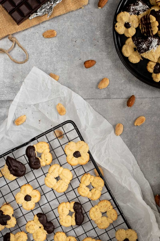 These keto almond spritz cookies are made using a cookie press. They are beyond simple to make, delicious, and baked in practically no time! #lowcarb #ketogenic #sugarfree #keto