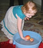 2 year old bobbing for apples