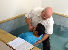 Bill baptizing Eduardo