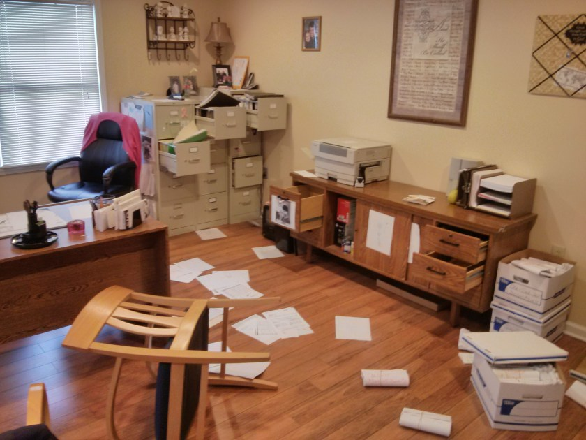 Picture of an office with papers on the floor