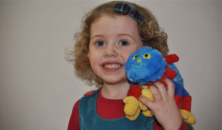 Woolly & Tig - A little girl and a blue spider toy