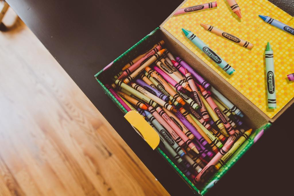 a box full of wax crayons