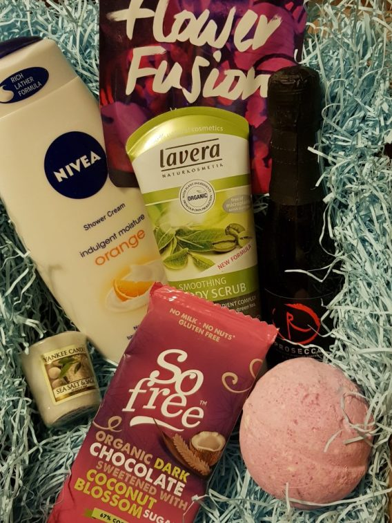 bodywash, a bath bomb, bar of chocolate and small bottle of wine
