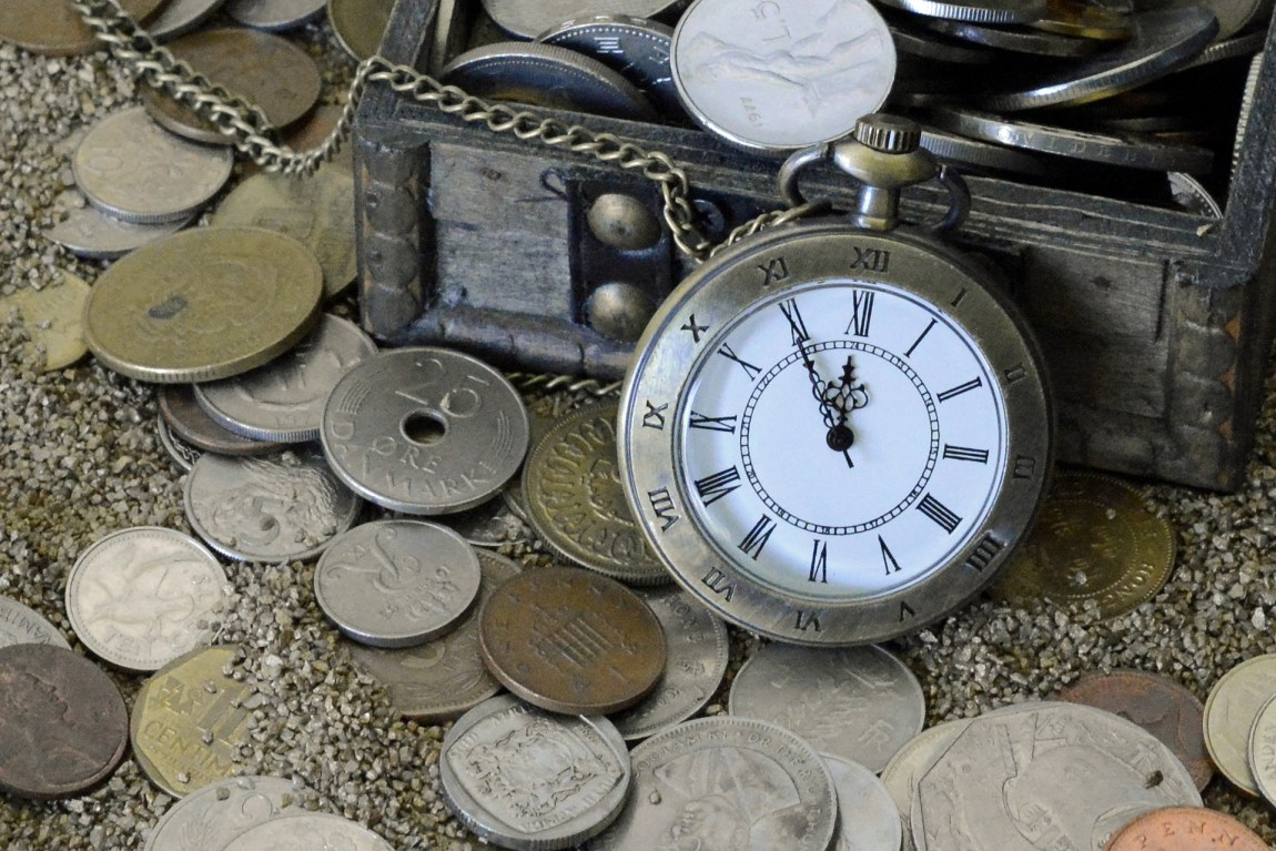 pocket watch and lots of old coins