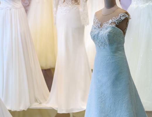 a number of wedding dresses on mannequins