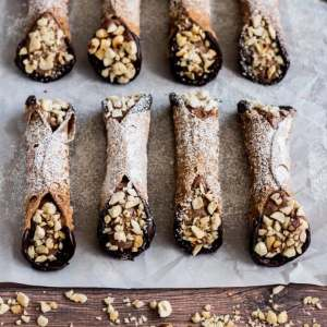 Chocolate Hazelnut Cannoli on parchment paper over a wood surface.