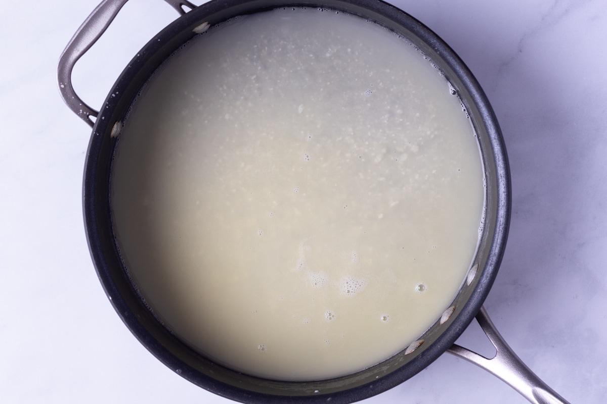 Fettuccine Alfredo Sauce in a pan from overhead.