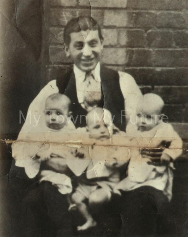 5702 Giovani Yafano with triplets
