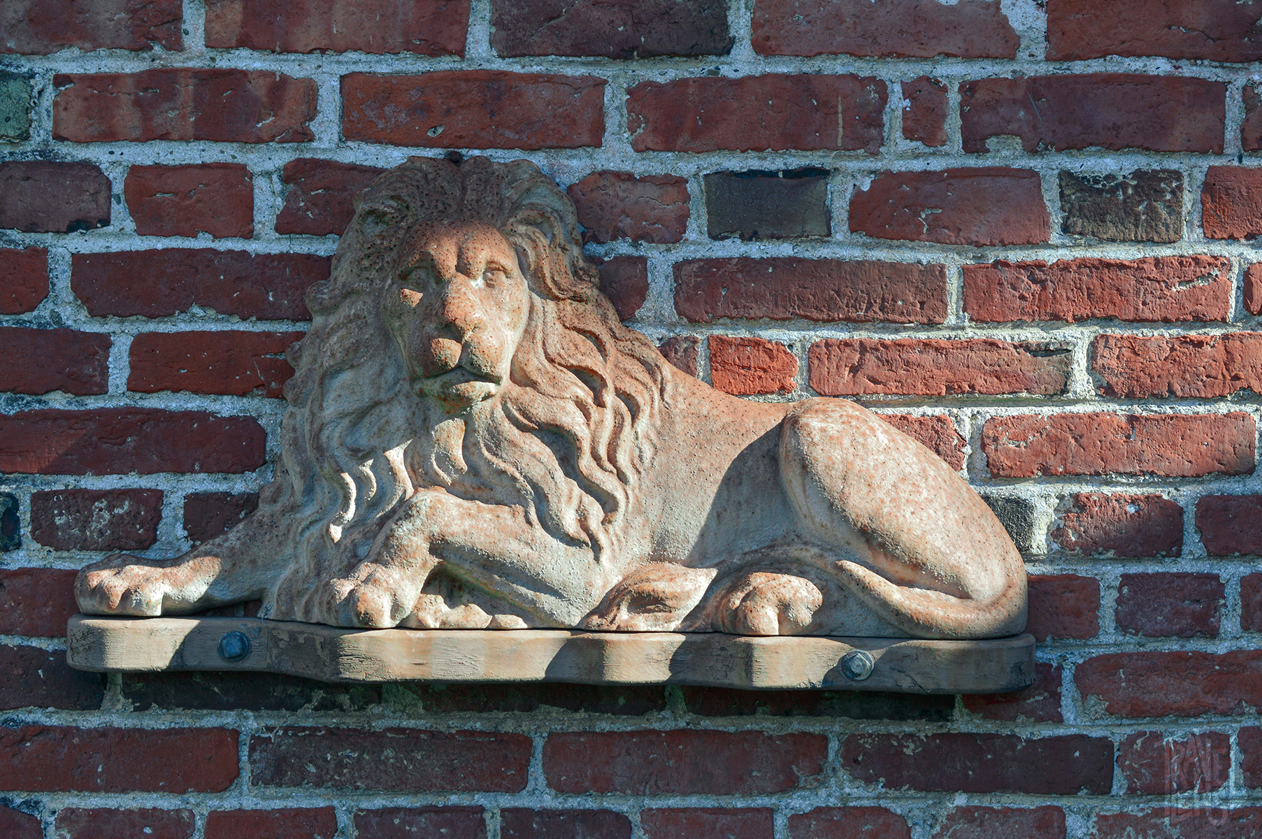 A lion on the brick of the Warner House in Portsmouth, NH
