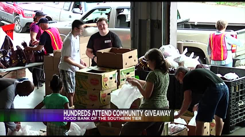 Hundreds attend community giveaway at the Food Bank_32050456