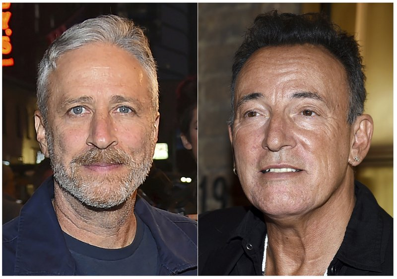 "This combination photo shows comedian Jon Stewart, left, and Bruce Springsteen at ""Springsteen On Broadway"" opening night at the Walter Kerr Theatre in New York. Stewart and Springsteen will once again headline this year's Stand Up for Heroes fundraiser, which benefits injured veterans and their families. (Photo by Evan Agostini/Invision/AP, File)"