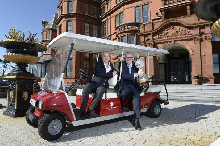 OPEN FOR BUSINESS: The European Tour's Antonia Beggs and Stephen Meldrum, General Manager of the Slieve Donard Resort & Spa, Newcastle celebrate the announcement that the hotel has been named as the Official Host Hotel for the 2015 Dubai Duty Free Irish Open hosted by The Rory Foundation.  The popular hotel, set against the stunning backdrop of the Mourne Mountains, will welcome world renowned golfers such as Rory McIlroy, Graeme McDowell, Darren Clarke, Ernie Els, Rickie Fowler, Padraig Harrington and Sergio Garcia all of whom will be competing in the eagerly anticipated event at neighbouring Royal County Down, widely regarded as one of the best golf courses in the world. For more information call the hotel on 028 4372 1066 or visit www.hastingshotels.com.