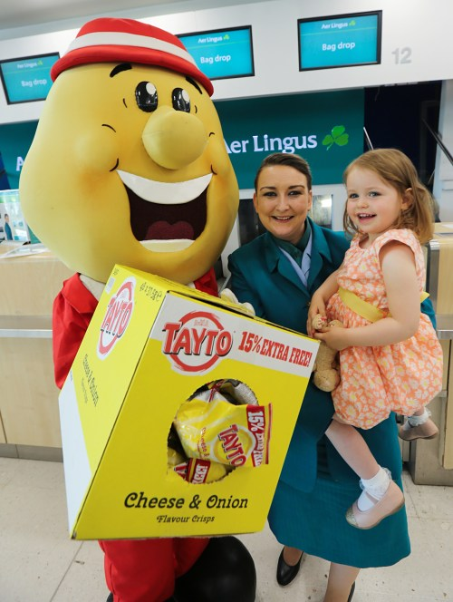 Mr Tayto makes a special delivery to George Best Belfast City Airport as Aer Lingus announce they are now serving Tayto crisp butties on board.  Pictured with Mr Tayto is Jo-Anne Taylor, Aer Lingus and passenger Ella McGovern, 2.