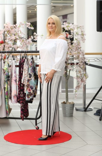 CMPR model Arlene Kelly wearing White 'Off the Shoulder' Top, £20 @ Dorothy Perkins, Stripped Wide Legged Trouser, £50 @ Evans