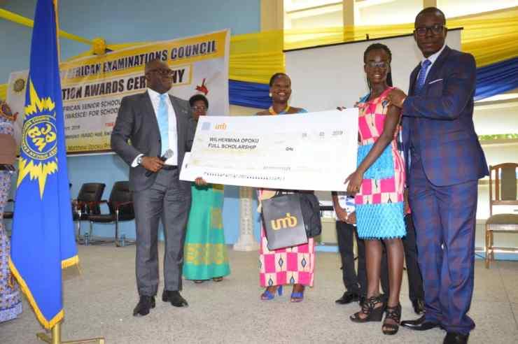 Mr. Kevin Adarkwah presenting full scholarship to 2018 WASSCE Overall Best Student, Wilhermina Opoku.