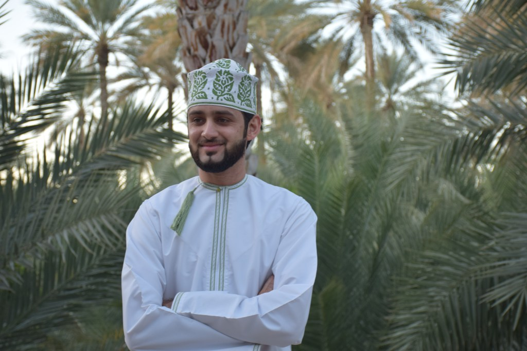 Omani man, Oman, palm trees, oasis, Adam town