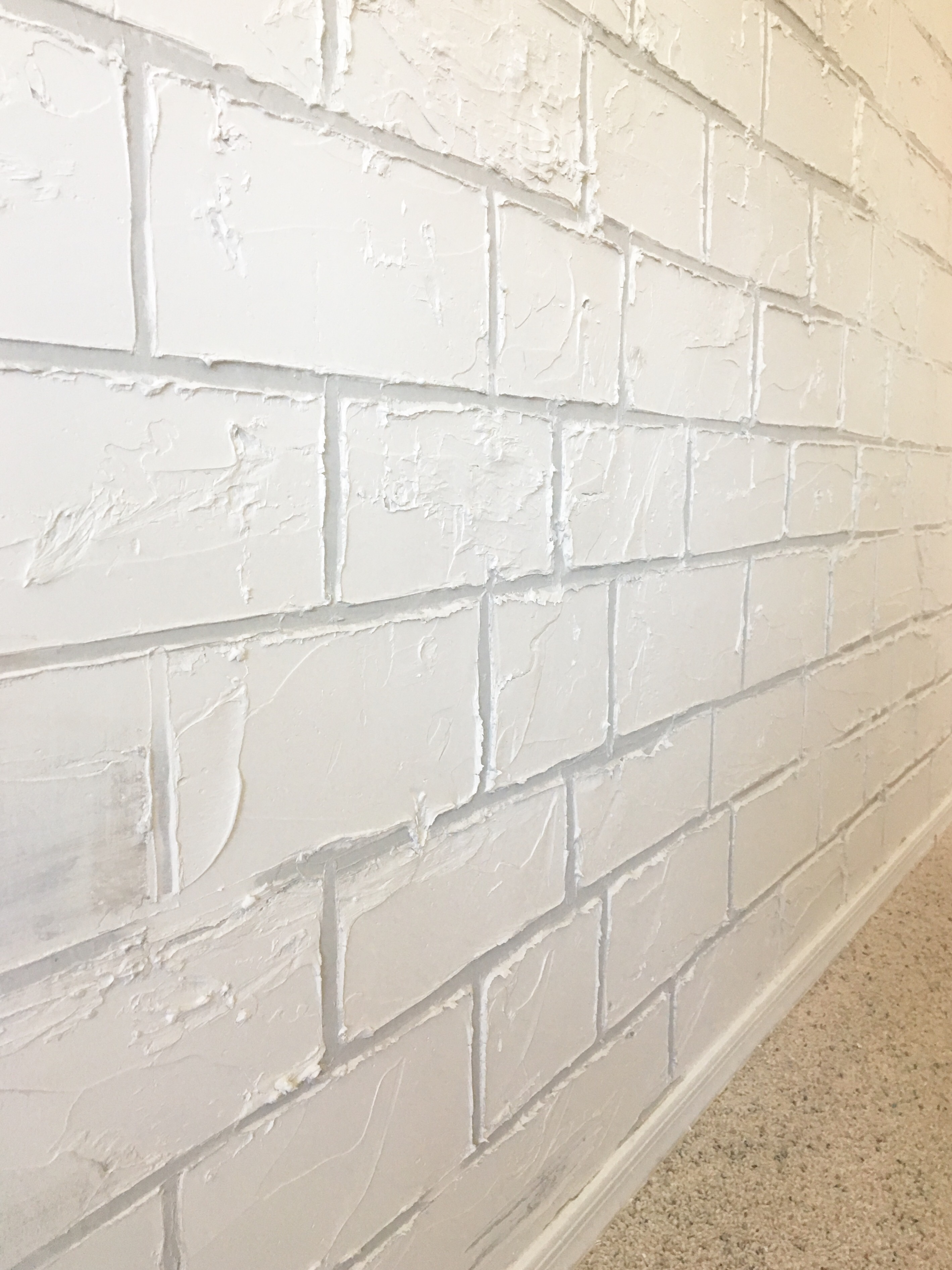 I started off by painting all of the grout lines with Toasty Grey Behr Paint  in flat finish. I used a 1 purdy brush for painting the grout and the  bricks.