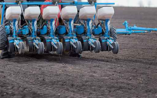 Tractor with seeder in sowing season_1560273917324