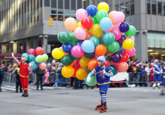 Do This, Not That // Macy's Thanksgiving Day Parade tips | Clowns with balloons at the Macy's Thanksgiving Day Parade in New York City