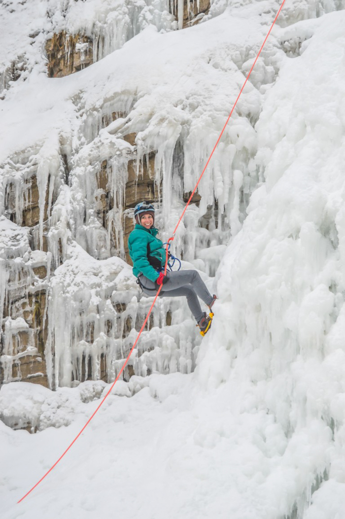 Ice Canyoning in Québec // Why You Should Be All up in This | Smiling on the frozen waterfall while ice canyoning in Québec